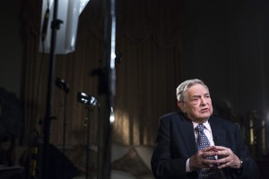 """George Soros, billionaire and founder of Soros Fund Management LLC, speaks during a Bloomberg Television interview recorded at his home in London, U.K., on Monday, March 24, 2015. The chances of Greece leaving the euro area are now 50-50 and the country could go """"down the drain,"""" billionaire investor Soros said. Photographer: Jason Alden/Bloomberg *** Local Caption *** George Soros"""